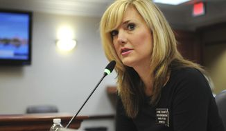 """FILE - In this an. 28, 2016 file photo, South Dakota Republican state Rep. Lyndi DiSanto speaks at the Capitol in Pierre, S.D. DiSanto, a South Dakota lawmaker who came under fire two years ago when she shared an """"All Lives Splatter"""" meme on Facebook, has resigned. A spokeswoman for Gov. Kristi Noem confirmed Tuesday, Nov. 26, 2019, that DiSanto of Box Elder has submitted her resignation. The Rapid City Journal reports DiSanto posted a message to her personal Facebook page saying she is planning to move out of state by Jan. 1. (AP Photo/James Nord, File)"""