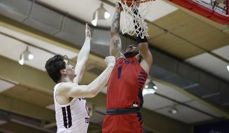 Dayton forward Obi Toppin (1) slam dunks over Virginia Tech guard Hunter Cattoor (0) during the first half of an NCAA college basketball game Tuesday, Nov. 26, 2019, in Lahaina, Hawaii. (AP Photo/Marco Garcia)