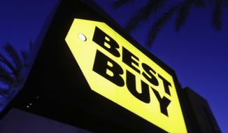 FILE- In this May 23, 2017, file photo, a Best Buy store sign is illuminated, in Orange, Calif.   Best Buy Co. on Tuesday, Nov. 26, 2019,  reported fiscal third-quarter profit of $293 million. The Richfield, Minnesota-based company said it had net income of $1.10 per share. Earnings, adjusted for one-time gains and costs, were $1.13 per share.(AP Photo/Chris Carlson, File)
