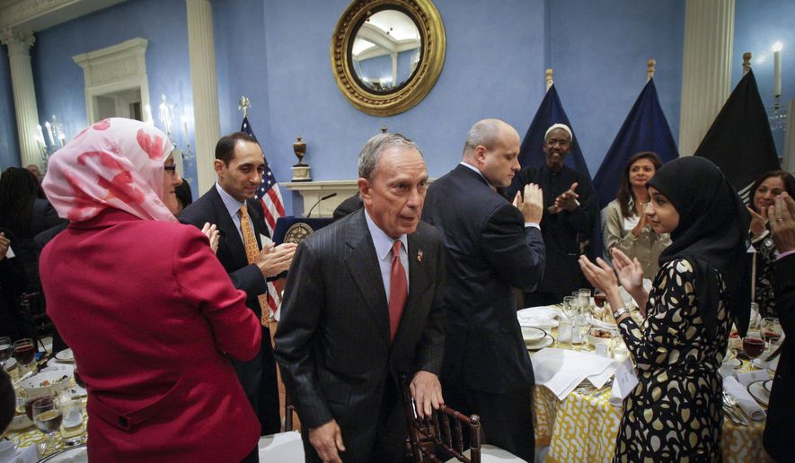 This photo from Tuesday Aug. 24, 2010, shows New York City Mayor Michael Bloomberg, returning to his seat after his remarks during a dinner in observance of Iftar at Gracie Mansion in New York. (AP Photo/Frank Franklin II, Pool, File)