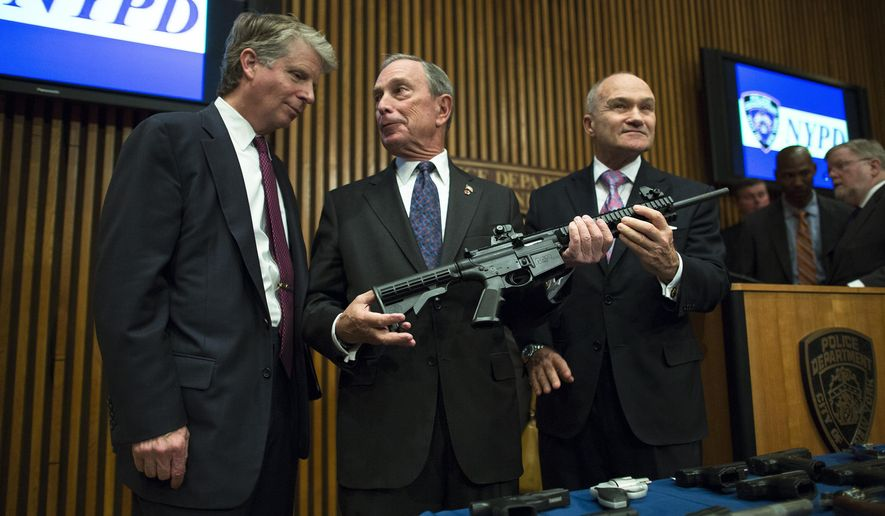 This photo from Friday, Oct. 12, 2012, shows District Attorney Cyrus Vance, left, Mayor Michael Bloomberg, center, NYPD Police Commissioner Ray Kelly, right, with confiscated illegal firearm during a press conference in New York. Bloomberg announced in May 2006 that he was suing 15 dealers he accused of selling firearms illegally in other states, resulting in court-appointed monitoring for many targeted shops. (AP Photo/John Minchillo, File) **FILE**