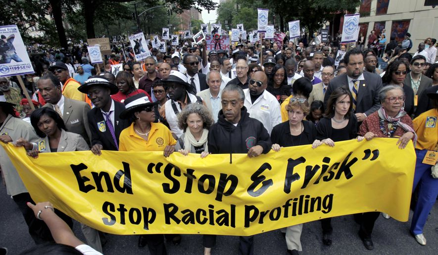 "This photo from Sunday, June 17, 2012, shows the Rev. Al Sharpton, center, with demonstrators during a silent march to end the ""stop-and-frisk"" program in New York. During the Bloomberg administration, civil rights groups went to court to end the NYPD's use of a tactic known as ""stop and frisk,"" which involved detaining, questioning and sometimes searching people deemed suspicious by officers. (AP Photo/Seth Wenig, File)"