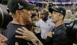 FILE - In this Feb. 3, 2013, file photo, San Francisco 49ers head coach Jim Harbaugh, left, greets Baltimore Ravens head coach John Harbaugh after the Ravens defeated the 49ers 34-31 in the NFL Super Bowl XLVII football game, in New Orleans. (AP Photo/Dave Martin, File)