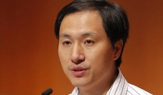FILE - In this Nov. 28, 2018, file photo, He Jiankui, a Chinese researcher, speaks during the Human Genome Editing Conference in Hong Kong. Chinese scientist He Jiankui shocked the world by claiming he had helped make the first gene-edited babies. One year later, mystery surrounds his fate as well as theirs. He has not been seen publicly since January, his work has not been published and nothing is known about the health of the babies.  (AP Photo/Kin Cheung, File)