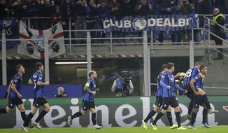 Atalanta's Luis Muriel, right, celebrates with his teammates after scoring his sides first goal during the Champions League group C soccer match between Atalanta and Dinamo Zagreb at the San Siro stadium in Milan, Italy, Tuesday, Nov. 26, 2019. (AP Photo/Luca Bruno)