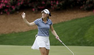 FILE - In this April 6, 2019, file photo, Jennifer Kupcho waves to the crowd after sinking a putt on the 13th hole during the final round of the Augusta National Women's Amateur golf tournament in Augusta, Ga. Kupcho's 3-hybrid into the 13th was among the best shots of the year. (AP Photo/David Goldman, File)