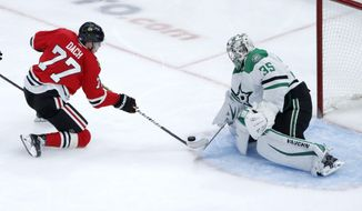 Dallas Stars goaltender Anton Khudobin (35) makes a save on a shot by Chicago Blackhawks' Kirby Dach (77) during the second period of an NHL hockey game Tuesday, Nov. 26, 2019, in Chicago. (AP Photo/Charles Rex Arbogast)