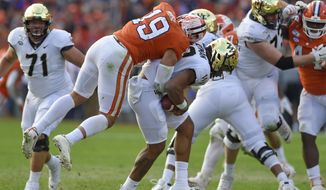 Clemson's Tanner Muse (19) sacks Wake Forest quarterback Jamie Newman during the first half of an NCAA college football game Saturday, Nov. 16, 2019, in Clemson, S.C. (AP Photo/Richard Shiro)