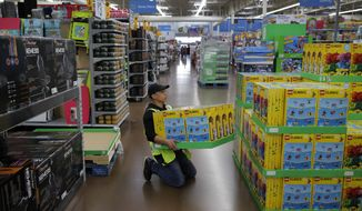Dan Villegas stocks items in preparation for a holiday sale at a Walmart Supercenter, Wednesday, Nov. 27, 2019, in Las Vegas. Black Friday once again kicks off the start of the holiday shopping season. But it will be the shortest season since 2013 because of Thanksgiving falling on the fourth Thursday in November, the latest possible date it can be. (AP Photo/John Locher) **FILE**