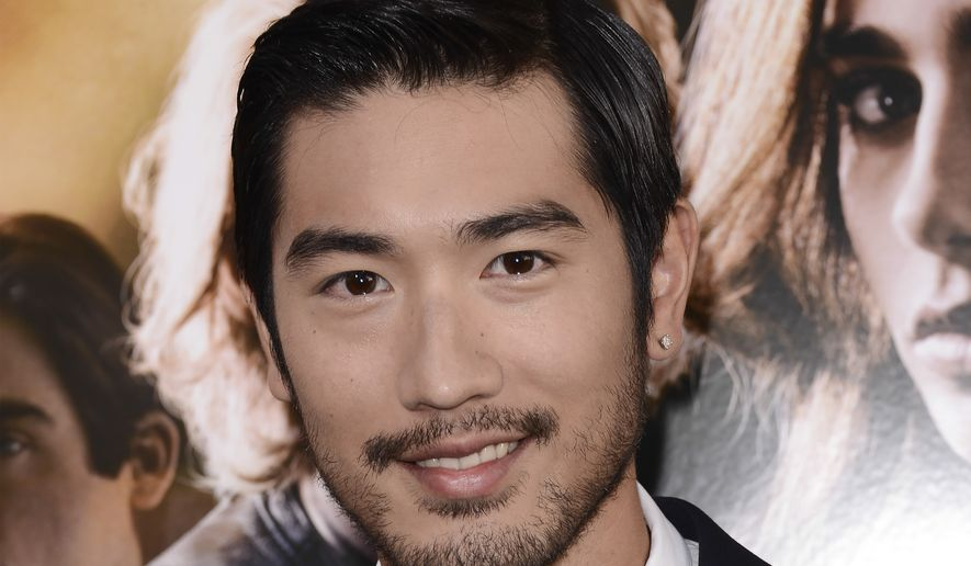 """In this August 12, 2013, file photo, actor Godfrey Gao arrives at the world premiere of """"The Mortal Instruments: City of Bones"""" at the ArcLight Cinerama Dome in Los Angeles. Gao has passed away while on set from an apparent heart attack. The 35-year-old Gao has passed away while on set from an apparent heart attack. Gao had been while filming a sports reality show in the eastern Chinese city of Ningbo on Wednesday when he died. His agency, JetStar Entertainment, confirmed his death on its official Facebook page. (Photo by Dan Steinberg/Invision/AP)"""