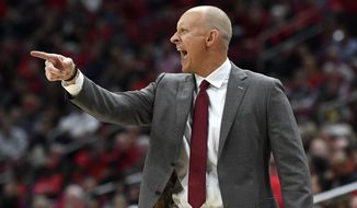 Louisville head coach Chris Mack shouts instructions to his players during the second half of an NCAA college basketball game against Akron in Louisville, Ky., Sunday, Nov. 24, 2019. (AP Photo/Timothy D. Easley)
