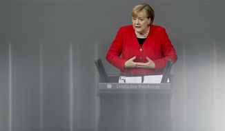German Chancellor Angela Merkel delivers a speech during a meeting about the budget 2020 of the German federal parliament, Bundestag, at the Reichstag building in Berlin, Germany, Wednesday, Nov. 27, 2019. (AP Photo/Michael Sohn)