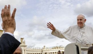 Pope Francis, right, waves as he leaves at the end of his weekly general audience, in St. Peter's Square at the Vatican, Wednesday, Nov. 27, 2019. (AP Photo/Andrew Medichini) **FILE**
