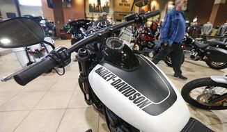 FILE - In this Oct. 17, 2019, file photo Harley Davidson motorcycles are on display at a dealership in Ashland, Va. On Wednesday, Nov. 27, the Commerce Department issues its October report on consumer spending, which accounts for roughly 70 percent of U.S. economic activity. (AP Photo/Steve Helber, File)