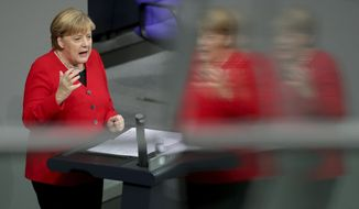 German Chancellor Angela Merkel delivers a peech during a meeting of the German federal parliament, Bundestag, at the Reichstag building in Berlin, Germany, Wednesday, Nov. 27, 2019. (AP Photo/Michael Sohn)