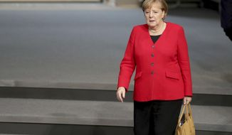 German Chancellor Angela Merkel arrives for a meeting about the German budget 2020 of the German federal parliament, Bundestag, at the Reichstag building in Berlin, Germany, Wednesday, Nov. 27, 2019. (AP Photo/Michael Sohn)