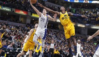 Indiana Pacers forward Doug McDermott (20) shoots in front of Utah Jazz forward Jeff Green (22) during the first half of an NBA basketball game in Indianapolis Wednesday, Nov. 27, 2019. (AP Photo/Michael Conroy)