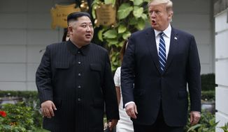 FILE - In this Feb. 28, 2019, file photo, U.S. President Donald Trump, right, and North Korean leader Kim Jong Un take a walk after their first meeting at the Sofitel Legend Metropole Hanoi hotel, in Hanoi. Fears rise that North Korea's year-end deadline to the U.S. to offer some new initiative to the nuclear-standoff means that nearly two years of head-spinning diplomatic engagement might be in danger of falling apart. (AP Photo/Evan Vucci, File)