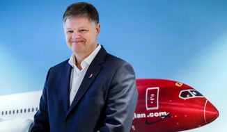 """Jacob Schram poses for the media after being announced as the new CEO of Norwegian Air Shuttle, in Oslo, Wednesday, Nov. 20, 2019. Low-cost carrier Norwegian Air Shuttle says it has tapped a new chief executive to succeed Bjoern Kjos, who turned the small domestic carrier into a global airline over 17 years as its CEO. Board chairman Niels Smedegaard says Jacob Schram was chosen """"after a thorough search process,"""" and he will start Jan. 1. (Vidar Ruud/NTB Scanpix via AP)"""