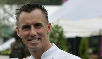 """In this June 16, 2005, file photo, celebrity chef Gary Rhodes poses for photographs at the launch of the """"Taste of London"""" festival in the city's Regent's Park. The family of British celebrity chef Gary Rhodes said Wednesday, Nov. 27, 2019, that he has died at the age of 59 with his wife Jennie by his side. (AP Photo/Matt Dunham, File)"""