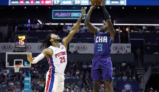 Detroit Pistons' Derrick Rose (25) tries to defend Charlotte Hornets' Terry Rozier (3) jump shot during the first half of an NBA basketball game in Charlotte, N.C., Wednesday, Nov. 27, 2019. (AP Photo/Bob Leverone)