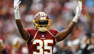 In this Oct. 14, 2018, photo, Washington Redskins strong safety Montae Nicholson (35) celebrates the Redskins victory after an NFL football game against the Carolina Panthers, in Landover, Md. Authorities say an autopsy is pending for a woman who died after being brought to a Virginia hospital by Nicholson. (AP Photo/Patrick Semansky)