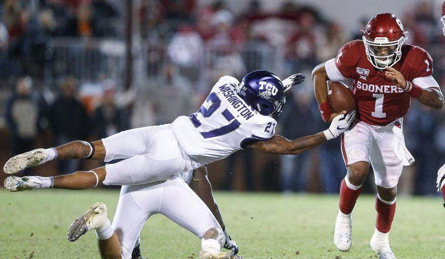 Oklahoma quarterback Jalen Hurts (1) avoids an attempted tackle by TCU safety Ar'Darius Washington (27) and linebacker Garret Wallow during an NCAA college football game Saturday, Nov. 23, 2019, in Norman, Okla. (Ian Maule/Tulsa World via AP)