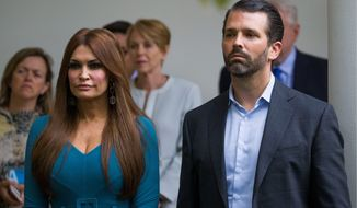 """Donald Trump Jr.'s book signing at UCLA with his girlfriend Kimberly Guilfoyle was disrupted by a group of far-right white nationalists who call themselves """"Groypers,"""" earlier this month. Mr. Trump was heckled off the stage. (Associated Press)"""