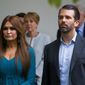 "Donald Trump Jr.'s book signing at UCLA with his girlfriend Kimberly Guilfoyle was disrupted by a group of far-right white nationalists who call themselves ""Groypers,"" earlier this month. Mr. Trump was heckled off the stage. (Associated Press)"