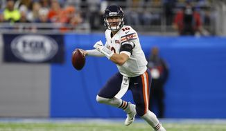 Chicago Bears quarterback Mitchell Trubisky scrambles during the second half of an NFL football game against the Detroit Lions, Thursday, Nov. 28, 2019, in Detroit. (AP Photo/Paul Sancya)