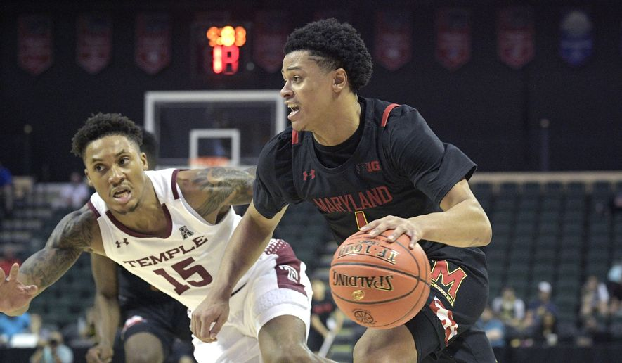 Maryland guard Anthony Cowan Jr. (1) drives to the basket in front of Temple guard Nate Pierre-Louis (15) during the second half of an NCAA college basketball tournament game Thursday, Nov. 28, 2019, in Lake Buena Vista, Fla. (AP Photo/Phelan M. Ebenhack)