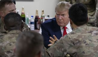 President Donald Trump speaking to members of the military in a dining facility during a surprise Thanksgiving Day visit, Thursday, Nov. 28, 2019, at Bagram Air Field, Afghanistan. (AP Photo/Alex Brandon)