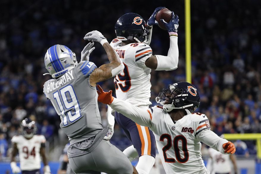 Chicago Bears free safety Eddie Jackson (39) intercepts a pass intended for Detroit Lions wide receiver Kenny Golladay (19) to seal the win over the Lions during the second half of an NFL football game, Thursday, Nov. 28, 2019, in Detroit. (AP Photo/Rick Osentoski)
