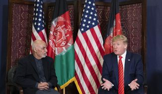 President Donald Trump speaks during a meeting with Afghan President Ashraf Ghani during a surprise Thanksgiving Day visit, Thursday, Nov. 28, 2019, at Bagram Air Field, Afghanistan. (AP Photo/Alex Brandon)