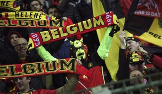 Belgium supporters celebrate at the end of the Euro 2020 group I qualifying soccer match between Belgium and Cyprus at the King Baudouin stadium in Brussels, Tuesday, Nov. 19, 2019. Belgium won 6-1. (AP Photo/Francisco Seco)