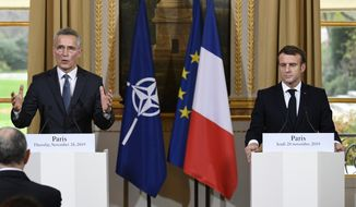 """French President Emmanuel Macron, right, and NATO Secretary General Jens Stoltenberg, hold a joint press conference at the Elysee palace, Thursday, Nov.28, 2019 in Paris. French President Emmanuel Macron said the NATO needed """"a wake up call"""" and that its leaders must have a strategic discussion about how the military alliance should work, including on improving ties with Russia. (Bertrand Guay, Pool via AP)"""