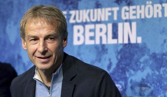 Juergen Klinsmann speaks during a press conference of German first division, Bundesliga, soccer team Hertha BSC Berlin in Berlin, Germany, Wednesday, Nov. 27, 2019. Klinsmann has been named the new coach of soccer club Hertha BSC Berlin after Ante Covic was fired with the team 15th in the German Bundesliga. Slogan in the background reads: 'The Future Belongs To Berlin'. (AP Photo/Michael Sohn)