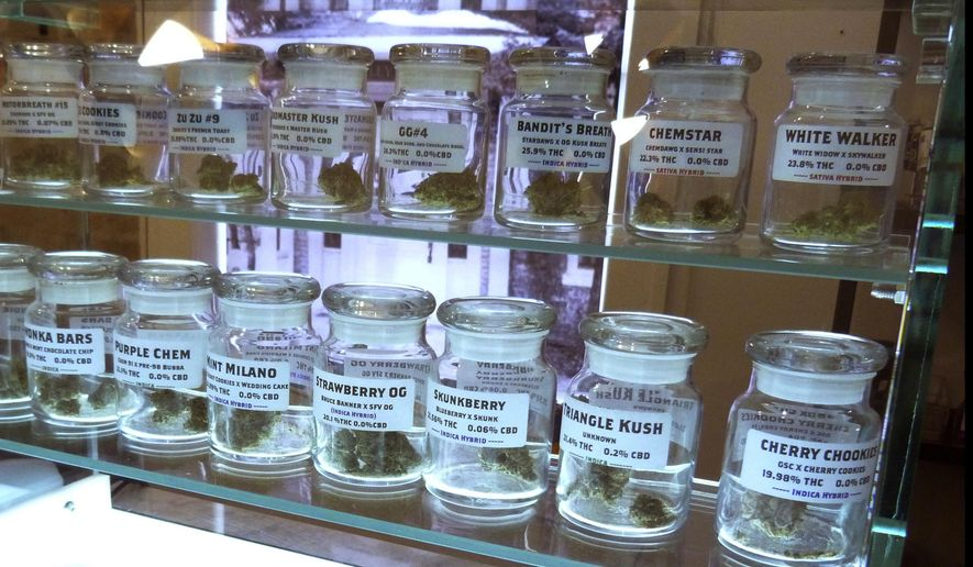 This Nov. 25, 2019 photo shows marijuana on display at Arbors Wellness in the medical marijuana shop in Ann Arbor, Mich. Adults age 21 and over will be able to buy marijuana for recreational use starting Sunday, Dec. 1 in Michigan. (AP Photo/David Eggert)