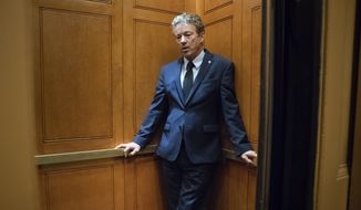 Sen. Rand Paul, R-Ky., waits inside an elevator after responding to reporters at the Capitol about his threat to reveal the name of the Ukraine whistleblower who helped initiate the impeachment inquiry against President Donald Trump by providing details ofTrump's call with the Ukrainian president, in Washington, Wednesday, Nov. 6, 2019. (AP Photo/J. Scott Applewhite)