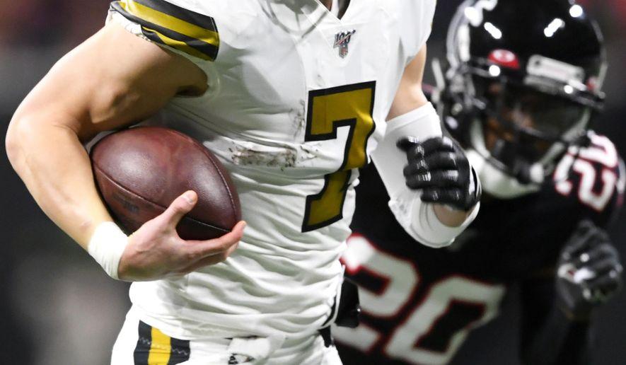 New Orleans Saints quarterback Taysom Hill (7) runs for a touchdown against the Atlanta Falcons during the first half of an NFL football game, Thursday, Nov. 28, 2019, in Atlanta. (AP Photo/John Amis)