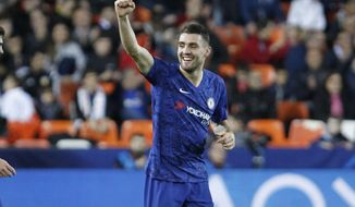 Chelsea's Mateo Kovacic celebrates after scoring the goal during the Champions League group H soccer match between Valencia and Chelsea at the Mestalla stadium in Valencia, Spain, Wednesday, Nov. 27, 2019. (AP Photo/Alberto Saiz)