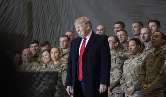 President Donald Trump smiles before addressing members of the military during a surprise Thanksgiving Day visit, Thursday, Nov. 28, 2019, at Bagram Air Field, Afghanistan. (AP Photo/Alex Brandon)