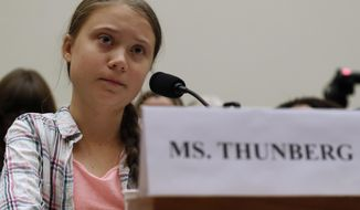 FILE - In this Wednesday, Sept. 18, 2019 file photo, youth climate change activist Greta Thunberg speaks at a House Foreign Affairs Committee subcommittee hearing on climate change on Capitol Hill in Washington. 'Generation Greta' has become a vocal force in the debate over global warming. (AP Photo/Jacquelyn Martin, file)