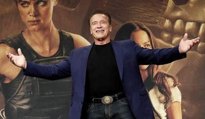 Actor Arnold Schwarzenegger gestures during a press conference to promote his latest movie 'Terminator: Dark Fate' in Seoul, South Korea, Monday, Oct. 21, 2019. The movie is to be released in South Korea on Oct. 30. (AP Photo/Ahn Young-joon)