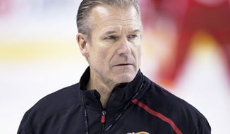 Calgary Flames interim head coach Geoff Ward directs the team during NHL hockey practice, Friday, Nov. 29, 2019, in Calgary, Alberta, following the resignation of head coach Bill Peters. (Larry MacDougal/The Canadian Press via AP) ** FILE **