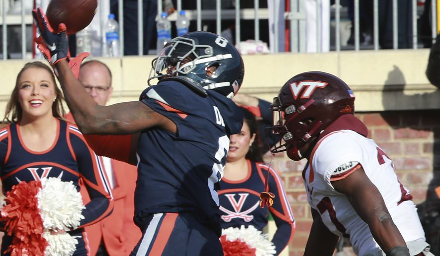 Virginia wide receiver Hasise Dubois (8) hauls in a pass near the goal line as Virginia Tech defensive back Armani Chatman (27) defends during the second half of an NCAA college football game Charlottesville, Va., Friday, Nov. 29, 2019. Virginia defeated Virginia Tech 39-30. (AP Photo/Steve Helber)