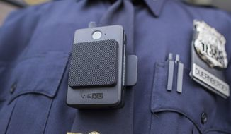 In this April 27, 2017, photo, a police officer wears a newly issued body camera in New York. (AP Photo/Mary Altaffer) **FILE**