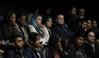 Students listen to politicians speaking during a Vote For Your Future Hustings at Westminster Kingsway College in London, Tuesday, Nov. 19, 2019.  There is a generation of young people who weren't old enough to vote in the Brexit referendum, but in a British election dominated by the Brexit issue those young voters could hold the key to victory for which-ever party can garner their vote. (AP Photo/Kirsty Wigglesworth)