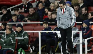 Arsenal's head coach Unai Emery reacts during the Europa League Group F soccer match between Arsenal and Eintracht Frankfurt at the Emirates Stadium, in London, Thursday, Nov. 28, 2019. (AP Photo/Matt Dunham)