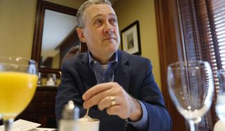 In this Nov. 19, 2019, photo James Bullard, president of the St. Louis Federal Reserve Bank, listens during an interview in Richmond, Va. (AP Photo/Steve Helber)